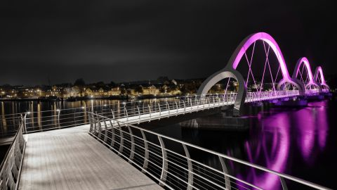 """In a rare twist, the <a href=""""http://www.ljusarkitektur.com/en/"""" target=""""_blank"""" target=""""_blank"""">Sölvesborg Bridge</a> -- Europe's longest pedestrian bridge at 2480 feet -- was specially enhanced by a lighting design firm rather than an architect. Ljusarkitektur mounted the structure with color-change LED lights."""