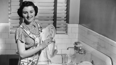 UNITED STATES - CIRCA 1950s:  Woman at sink washing dishes.  (Photo by George Marks/Retrofile/Getty Images)