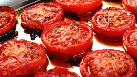 """<a href=""""http://www.ncbi.nlm.nih.gov/pubmed/11192026"""" target=""""_blank"""" target=""""_blank"""">Studies</a> show that cutting and heating tomatoes opens up the <a href=""""http://www.ncbi.nlm.nih.gov/pubmed/11192026"""" target=""""_blank"""" target=""""_blank"""">cell wall of the fruit</a>, which allows greater access to the health benefits of lycopene. Adding a bit of healthy fat, such as olive oil, also helps."""