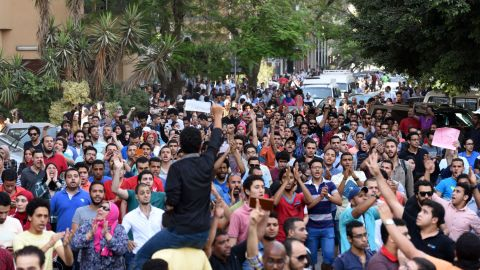"""Egyptian protesters chant slogans during a demonstration in Cairo on April 25, 2016, against the handing over of two Red Sea islands to Saudi Arabia. Egyptian police fired tear gas at protesters in the Egyptian capital who defied government warnings and held a rally calling for the """"downfall"""" of the regime, quickly scattering them and making arrests.  / AFP / MOHAMED EL-SHAHED        (Photo credit should read MOHAMED EL-SHAHED/AFP/Getty Images)"""