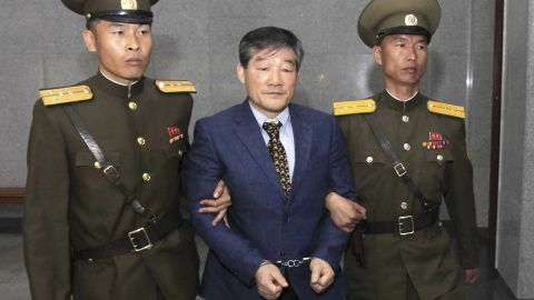 Kim Dong Chul, center, a U.S. citizen detained in North Korea, is escorted to his trial Friday, April 29, 2016, in Pyongyang, North Korea. A North Korean court has sentenced an ethnic Korean U.S. citizen to 10 years in prison for what it called acts of espionage. (AP Photo/Kim Kwang Hyon)