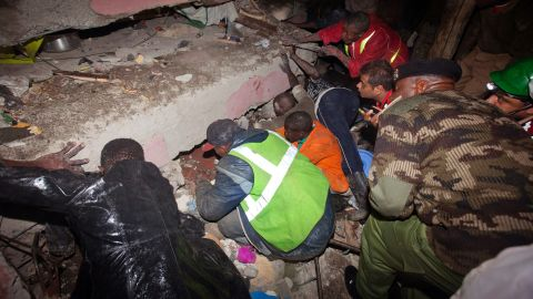 Rescue personnel work at the site of the collapse.