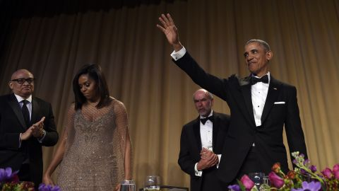President Barack Obama, right, waves after speaking at the annual White House Correspondents' Association dinner at the Washington Hilton, in Washington, Saturday, April 30, 2016. Larry Wilmore, guest host from Comedy Central, left, first lady Michelle Obama, second from left, and Jerry Seib, second from fight, of The Wall Street Journal, join Obama on the stage. (AP Photo/Susan Walsh)