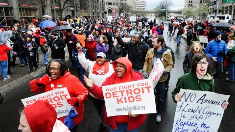Members of the Detroit teachers union march Monday outside school district offices.
