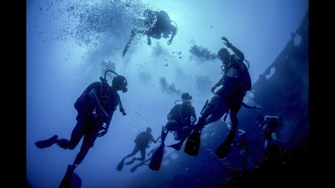 U.S. and Sri Lankan sailors swim near the Tokai Maru, a sunken Japanese freighter from World War II, during a joint diving exercise in Apra Harbor, Guam, April 13, 2016. Navy photo by Petty Officer 3rd Class Alfred A. Coffield