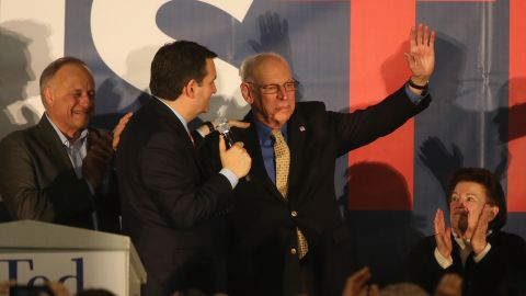 Ted Cruz (R-TX) hugs his father Rafael Cruz, as his mother Eleanor Darragh looks on at the  caucus night gathering at the Iowa State Fairgrounds on February 1, 2016 in Des Moines, Iowa.