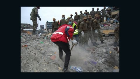Kenyan rescue and recovery workers at the scene of a building collapse in Nairobi.