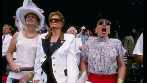 """""""The style in the infield is relaxed, with women wearing cool sundresses, cotton skirts, or more frequently shorts,"""" said the <a href=""""https://www.kentuckyderby.com/history/fashion/1990s"""" target=""""_blank"""" target=""""_blank"""">Derby website </a>of 1990s styles."""