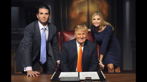 """Trump appears on the set of """"The Celebrity Apprentice"""" with two of his children -- Donald Jr. and Ivanka -- in 2009."""