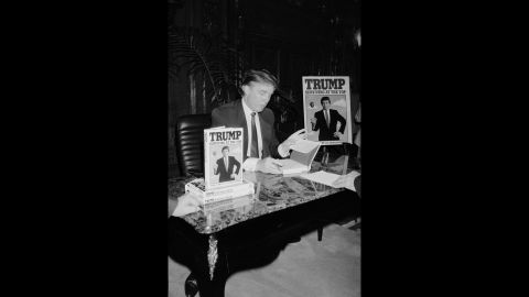 """Trump signs his second book, """"Trump: Surviving at the Top,"""" in 1990. Trump <a href=""""http://www.trump.com/publications/"""" target=""""_blank"""" target=""""_blank"""">has published</a> at least 16 other books, including """"The Art of the Deal"""" and """"The America We Deserve."""""""