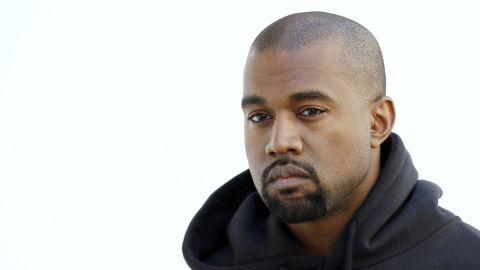 American rapper Kanye West poses before Christian Dior 2015-2016 fall/winter ready-to-wear collection fashion show on March 6, 2015 in Paris. AFP PHOTO / PATRICK KOVARIK