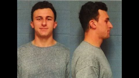 """Football player <a href=""""http://www.cnn.com/2016/05/04/us/johnny-manziel-booked/index.html"""" target=""""_blank"""">Johnny Manziel</a> turned himself turned himself in to police in Highland Park, Texas, on Wednesday, May 4, and was booked on misdemeanor assault charges, said Lt. Lance Koppa with the Highland Park Department of Public Safety. Manziel is accused of assaulting his former girlfriend in January. He has denied hitting her, and his lawyer said he'll plead not guilty."""