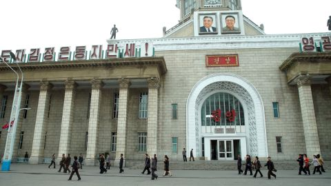 Portraits of former leaders Kim Il Sung and Kim Jong Il look down from the clock tower of Pyongyang Central Railway Station. The station is a major hub for travelers to and from the capital, including many of the delegates for the upcoming Workers' Party Congress, which starts on May 6.
