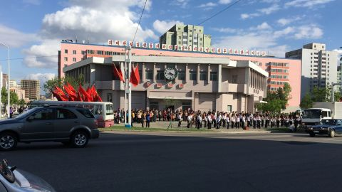 """A student band outside Hyoksin (Innovation) Station is tasked with lifting the spirits of Pyongyang citizens so they'll work harder during the """"70 day battle"""" leading up to the congress."""