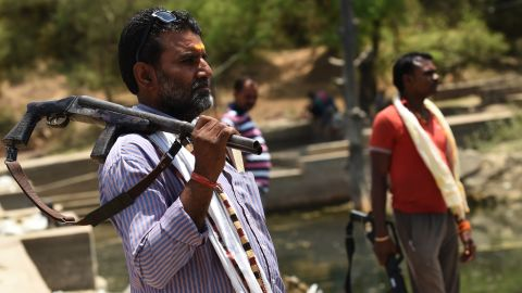 India was hit by the worst drought in decades in 2016. Here, gunmen stand alert at a water reservoir in Tikamgarh, India, on April 27.