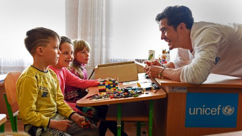 UNICEF Goodwill Ambassador Orlando Bloom plays with Lego with pupils of School #13 in Slovyansk, on April 27, 2016, as part of a visit to conflict-hit eastern Ukraine.  He was in the country to raise awareness of the global education crisis facing children in emergencies.