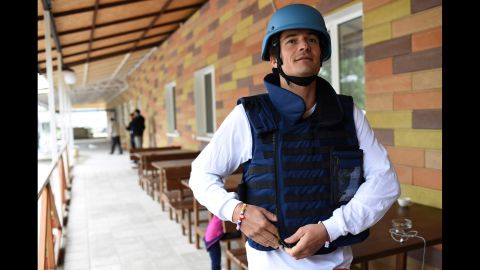 Orlando Bloom prepares to travel near the front line of the conflict in eastern Ukraine.  He was required to wear a flak jacket and helmet.
