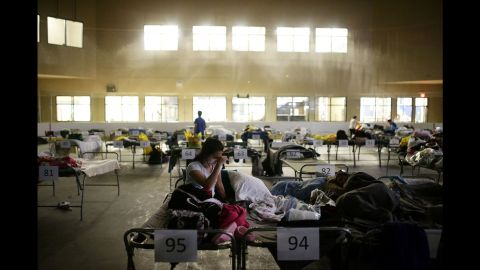 Tyra Abo sits on a cot at a makeshift evacuation center in Lac la Biche, Alberta, on May 5.