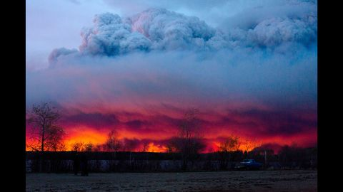 The wildfire moves toward the town of Anzac on Wednesday, May 4.