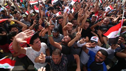 """Iraqi protesters gather in the parade grounds outside the parliament in Baghdad's heavily fortified """"Green Zone"""" on May 1, 2016, a day after supporters of Shiite cleric Moqtada al-Sadr broke into the area after lawmakers again failed to approve new ministers. Protesters were withdrawing from Baghdad's Green Zone after breaking into the fortified area and storming Iraq's parliament in an unprecedented security breach the day before. The move, which lessens the pressure on politicians in Baghdad, came as rare bombings in the south killed 33 people and wounded dozens. / AFP / HAIDAR MOHAMMED ALI        (Photo credit should read HAIDAR MOHAMMED ALI/AFP/Getty Images)"""