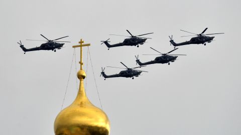 Russian Mil Mi-28 helicopter gunships fly above the Kremlin's cathedrals in Moscow, on May 7, 2014.