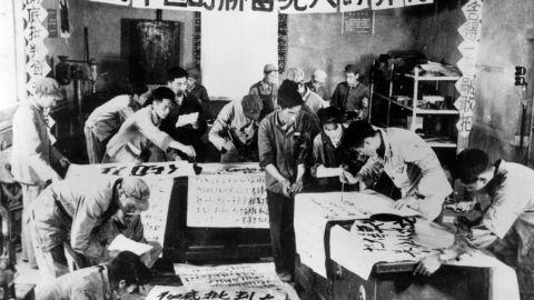 Cultural Revolution activists write anti-capitalist slogans.