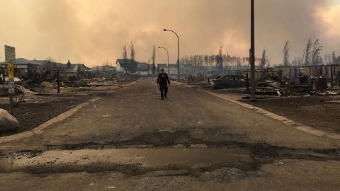 A member of the Royal Canadian Mounted Police surveys wildfire damage in Fort McMurray. The RCMP tweeted the photo on May 5.
