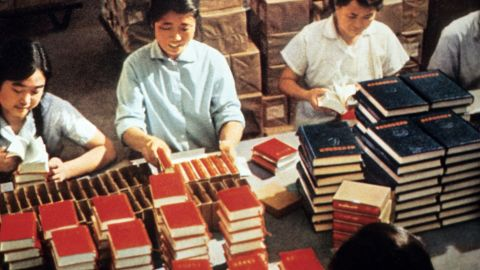 """Employees of the Government Printing House pack in 1971 in Bejing copies of Mao Zedong's """"Little Red Book,"""" the bible of the Maoism, teaching the philosophy of Mao -- a revolutionary ideology based on Marxism-Leninism adapted to Chinese conditions. Maoism shifted the focus of revolutionary struggle from the urban workers or proletariat to the countryside and the peasantry. Mao, who was Chairman of the Chinese Communist Party (CCP) from 1935 until his death in 1976, launched in 1966 the """"Great Proletarian Cultural Revolution"""", directed against those CCP """"party leaders taking the capitalist road"""". Mao's shock troops were to be the Red Guards, principally middle-school and university students who were to draw inspiration from Mao himself-now supreme authority in all matters.   CHINA OUT        (Photo credit should read STR/AFP/Getty Images)"""