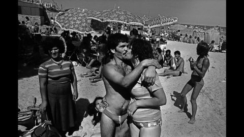 """Battaglia's new book """"Anthology"""" also includes shots of regular Sicilians going about their day, such as this beach photo from 1982. """"My archives are full of blood,"""" she said. """"But I have also seen such immense beauty in the regular, complicated daily life in Sicily."""""""
