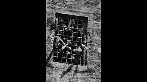 Prisoners are seen behind bars in Palermo in 1983.