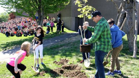 Chad Pregracke and his nonprofit surprised students by planting the group's 1 millionth tree at their school.