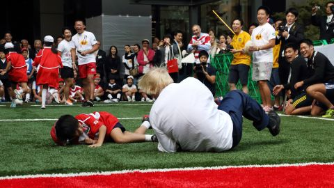 """London Mayor Boris Johnson <a href=""""http://www.cnn.com/2015/10/15/sport/london-mayor-boris-johnson-rugby/index.html"""" target=""""_blank"""">knocks over 10-year-old Toki Sekiguchi</a> during a touch rugby game in Tokyo on October 15, 2015. """"I accidentally flattened a 10-year-old on TV unfortunately,"""" Johnson said in a speech to British and American businessmen. """"But he bounced back, he put it behind him. The smile returned rapidly to his face."""""""