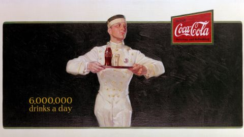 """<strong>1925:</strong> Coca-Cola's first billboard, """"Ritz Boy,"""" promotes how popular the drink had become."""