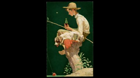 """<strong>1935:</strong> Between 1928 and 1935, artist Norman Rockwell painted six different illustrations that were used in Coca-Cola ads. The 1935 calendar featured """"Out Fishin,"""" which depicted a young boy fishing on a tree stump."""