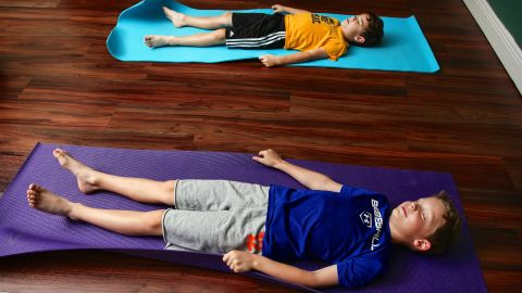Imagining their yoga mats as magic carpets helps the boys learn mindfulness.