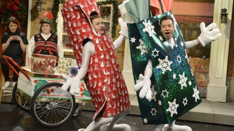 """Timberlake, part of an exclusive club of people who have hosted """"Saturday Night Live"""" five times, <a href=""""http://www.cnn.com/videos/showbiz/2013/12/22/newday-vo-snl-justin-timberlake-wraps-gifts.cnn"""">""""wraps""""</a> with Jimmy Fallon during a skit in December 2013."""