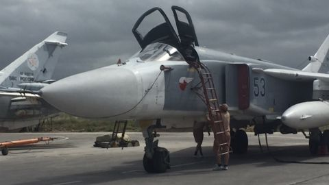 A SU-24 Russian strike aicraft at the Hmeymim airbase in Syria, May 4, 2016.