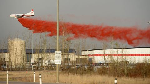 A plane drops fire retardant in Fort McMurray on May 6.