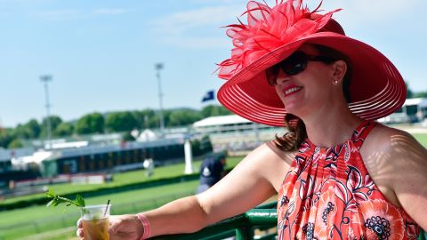Drink in hand, the racegoer is prepared for the day.