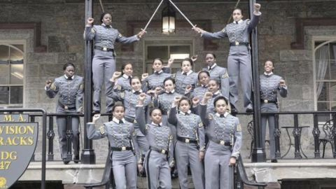 This undated image obtained from Twitter on Saturday, May 7, 2016 shows 16 black, female cadets in uniform with their fists raised while posing for a photograph at the United States Military Academy at West Point, N.Y. The U.S. Military Academy has launched an inquiry into the image that has spurred questions about whether the gesture violates military restrictions on political activity. (Obtained from Twitter via AP)