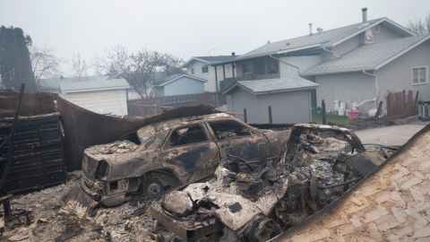 Charred vehicles sit in a heavily damaged residential neighborhood on May 7.