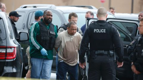 Police take Eulalio Tordil, 62, a suspect in three fatal shootings in the Washington, D.C., area into custody in Bethesda, Md., Friday.