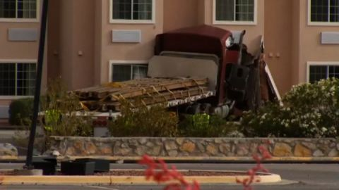 Police say the 18-wheeler left Interstate 10 in El Paso and crashed into a hotel, killing a man in his room