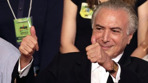 FILE - In this March 12, 2016, file photo, Brazil's Vice President Michel Temer flashes two thumbs up during the Brazilian Democratic Movement Party, national convention in Brasilia, Brazil. The son of Lebanese immigrants, Temer is one of the countrys least popular politicians but has managed to climb his way to the top, in large part by building close relationships with fellow politicians as leader of the large but fractured Brazilian Democratic Movement Party. (AP Photo/Eraldo Peres, File)