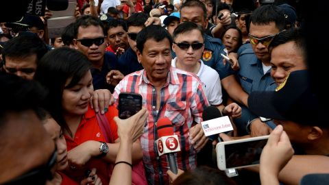 Presidential frontrunner and Davao City Mayor Rodrigo Duterte leaves the voting precint after casting his vote at Daniel Aguinaldo National High School in Davao City, on the southern island of Mindanao on May 9, 2016.