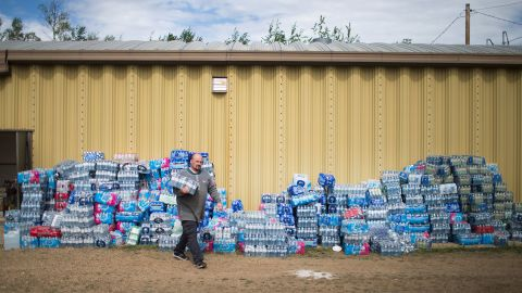Rodney Howse gets water at a donation center on May 8. The center was established to help evacuees who were forced from their homes by the wildfire.