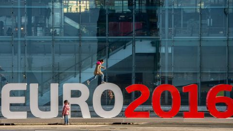 """Children play on February 3, 2016 around giant letters of the """"UEFA EURO 2016"""" in Lille  where some of the Euro 2016 football matches will take place. / AFP / PHILIPPE HUGUEN        (Photo credit should read PHILIPPE HUGUEN/AFP/Getty Images)"""