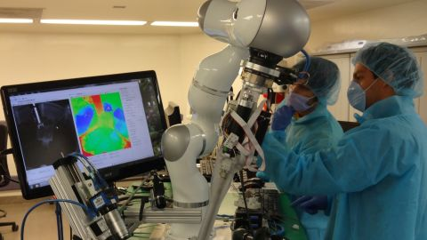 Surgeons monitor an operation performed by the Smart-Tissue Autonomous Robot (STAR).