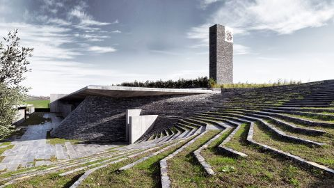 Completed in 2012 in Büyükçekmece, a suburb of Istanbul, this mosque is built of rough stone and concrete and, set in a hollow, is reached by stepping-stones across a pool.