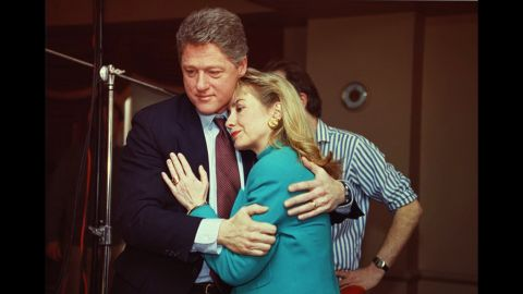 """Bill Clinton comforts his wife on the set of """"60 Minutes"""" after a stage light broke loose from the ceiling and knocked her down in January 1992."""